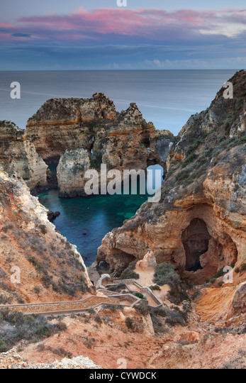 Ponta da Piedade sea stacks and arches captured at dawn, Portugal. - Stock-Bilder
