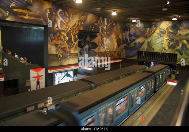 Chile Santiago Metro Station Universidad de Chile subway public transportation rapid transit train platform mural - Stock Image