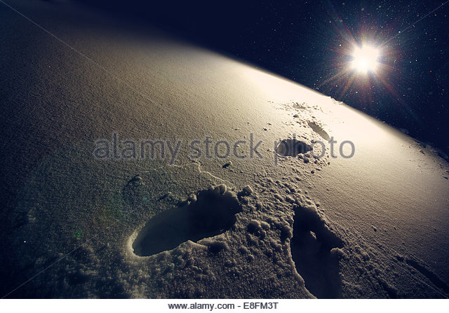 Footprints In Snow in bright sunlight - Stock Image