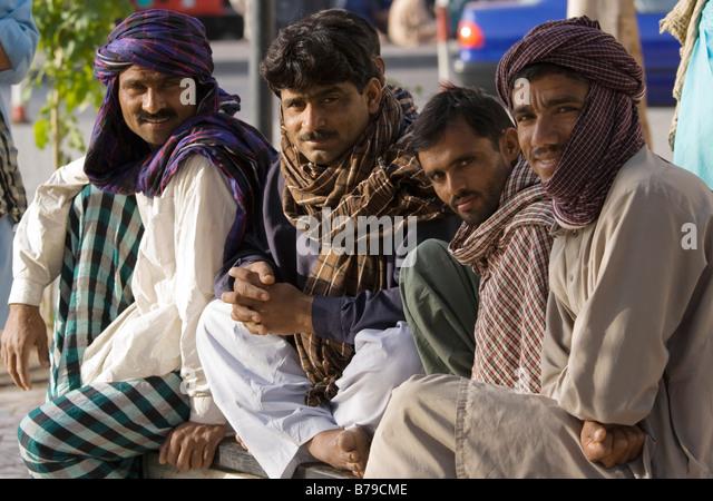 Group of dock workers, Dubai Creek - Stock Image