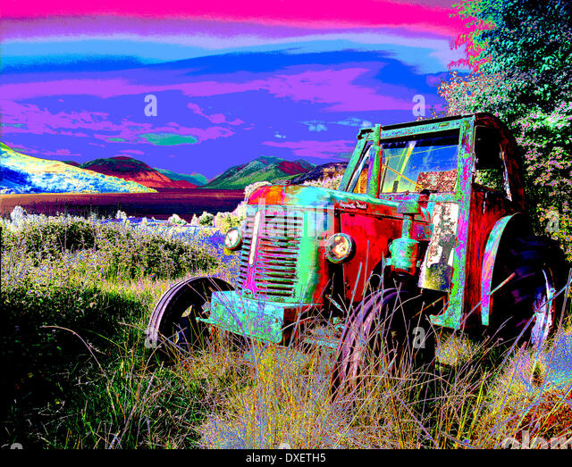 Abstract art picture of old tractor in field. - Stock Image