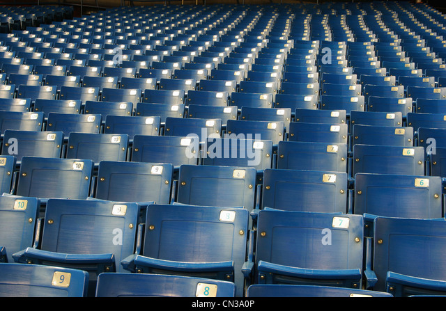 Empty blue stadium seats - Stock Image