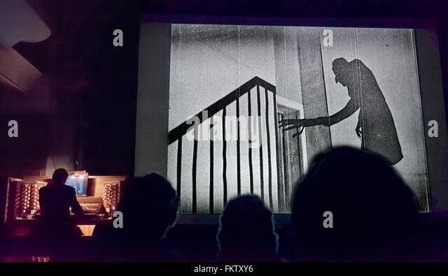A showing of the silent black and white film Nosferatu in a church with organ accompaniment - Stock Image