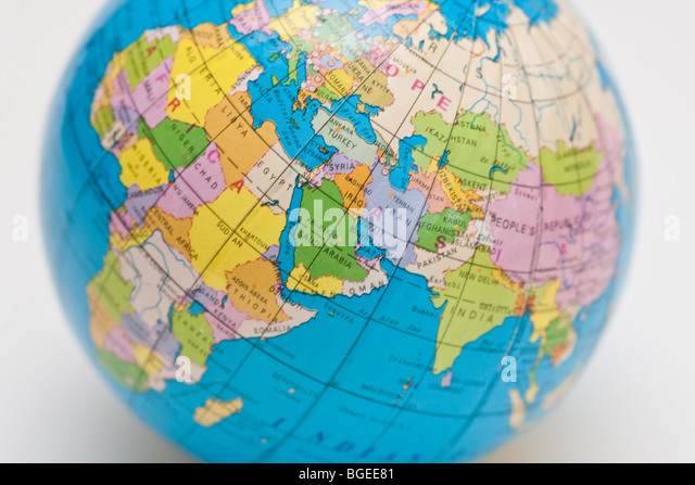 globe tilted to the side lying on a desk - Stock Image