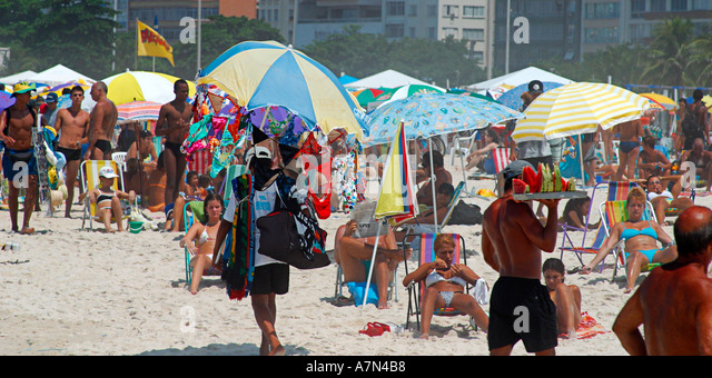 Rio de Janeiro Copacabana beach sunday beachlife traders with fruit and clothes - Stock Image