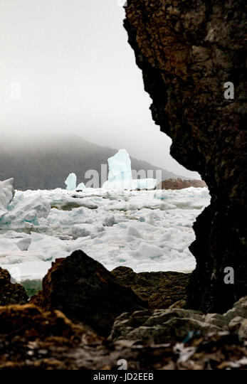 Large iceberg and sea ice in Durrell, Twillingate, Newfoundland, Canada - Stock Image