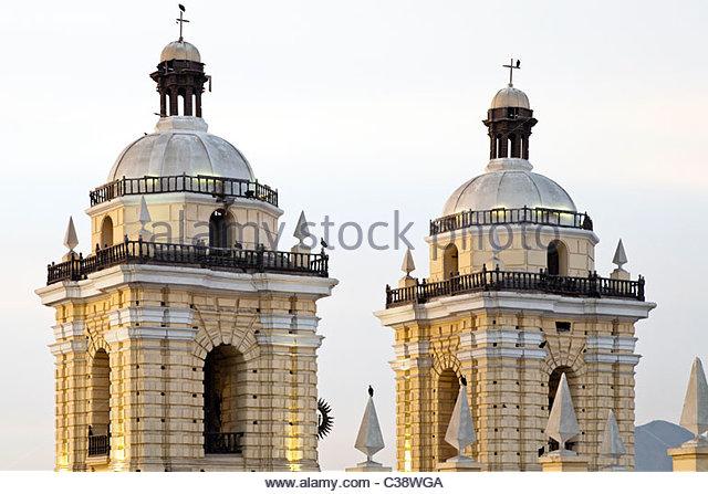 Belltowers of Basilica y Convento de San Francisco de Lima (Saint Francis Monastery) at sunset. Lima, Peru - Stock Image