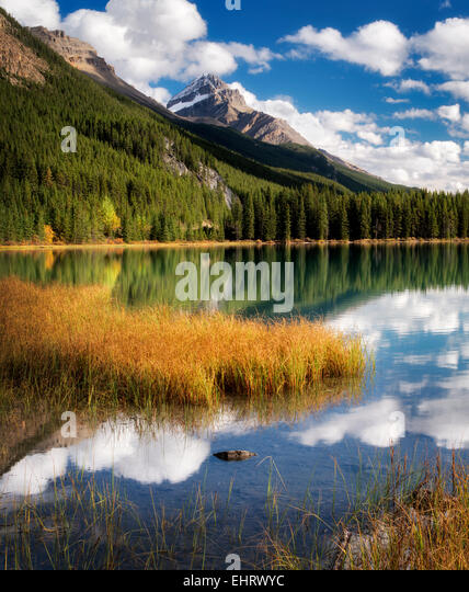 Clouds and reflection in Waterfowl Lakes. Banff National Park. Alberta. Canada. - Stock Image