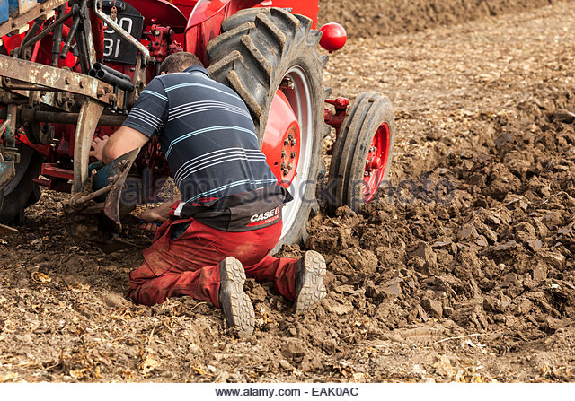 Guy Fixing Tractor : Plough man stock photos images alamy