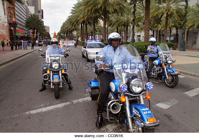 New Orleans Louisiana downtown Canal Street Festival of India Hare Krishna Hinduism religion parade police motorcycle - Stock Image