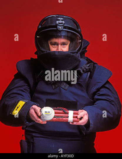 police technician carrying time bomb - Stock Image