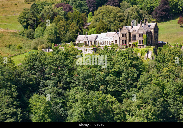 Cressbrook Hall perched high above the River Wye and Water cum Jolly Dale in the Derbyshire Peak district - Stock Image