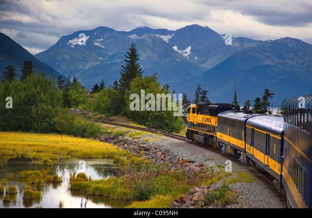 View of an Alaska Railroad train travelling between Anchorage and Seward along Turnagain Arm in Southcentral Alaska, - Stock Image