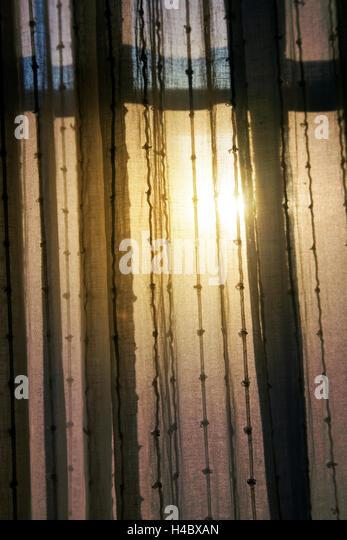 Natural Light Filtered Through Dark Curtains