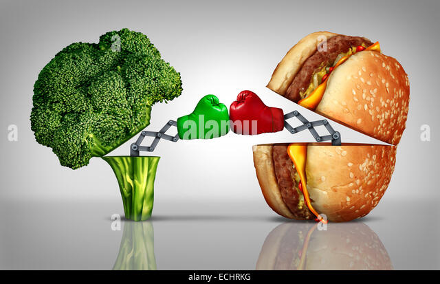 Food fight nutrition concept as a fresh healthy broccoli fighting an unhealthy cheese burger with boxing gloves - Stock-Bilder