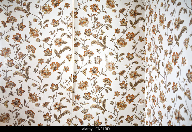 Peeling floral wallpaper - Stock Image