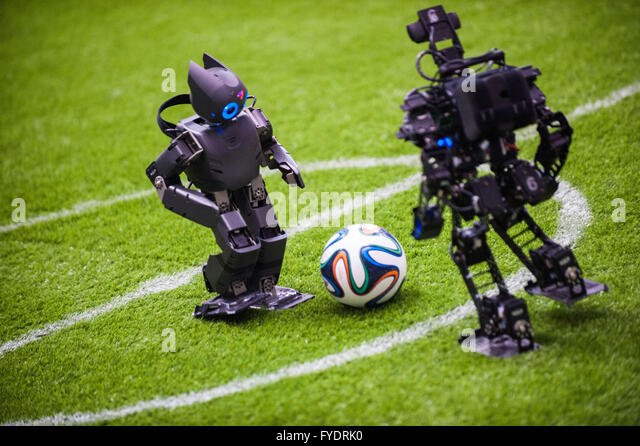 Hefei, China's Anhui Province. 26th Apr, 2016. Robots from Sichuan University (L) and Southeast University compete - Stock Image