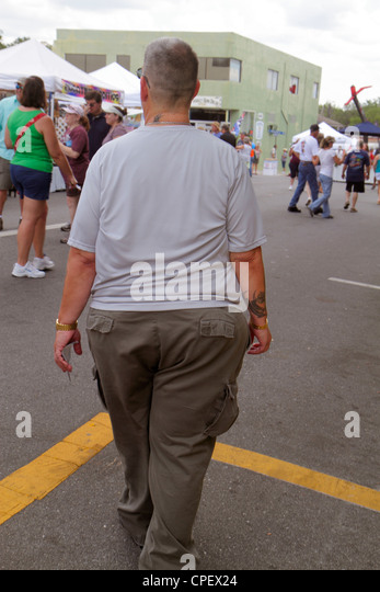 Florida Brooksville Florida Blueberry Festival annual event Broad Street man overweight heavyset fat - Stock Image