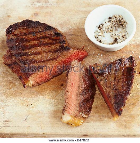 Beef steak (medium) with salt and pepper - Stock Image