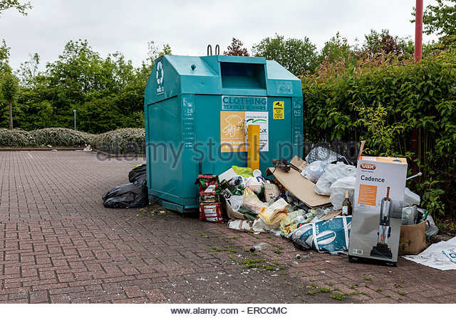 Recycling Point with overflowing rubbish - Stock Image