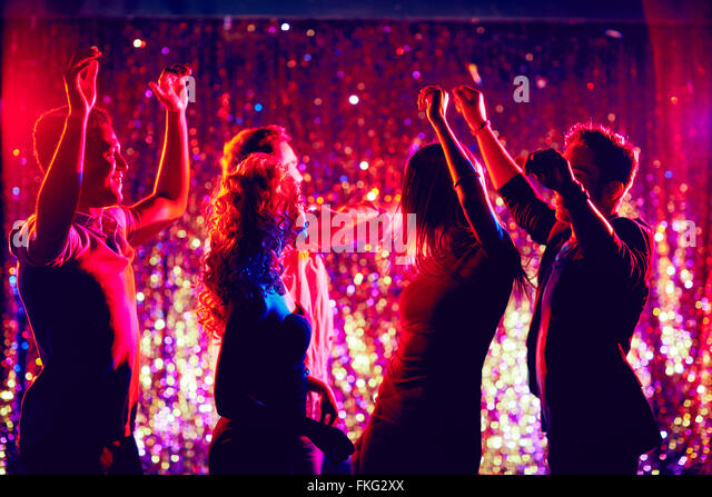 Group of people dancing in disco club to the music - Stock Image