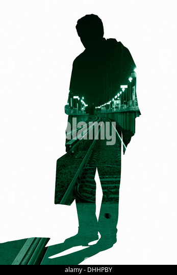 Cut out silhouette of businessman with urban scene - Stock Image