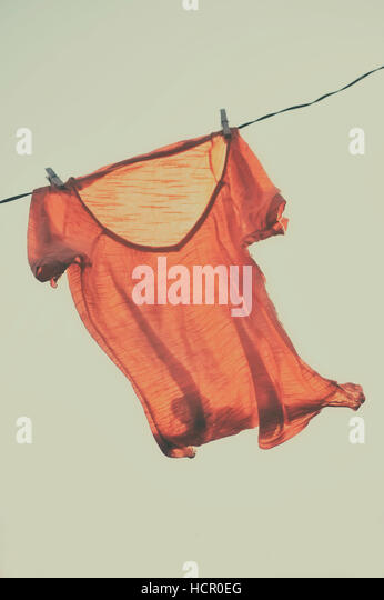 T-shirt to dry on a clothesline - Stock Image