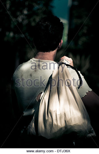 Time For A Change Of Location Said The Drifter Man Holding His Life Belonging In A Sack, Leaving Behind His Old - Stock Image