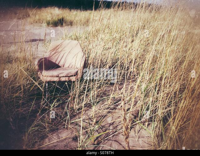 Chair on the beach - Stock Image
