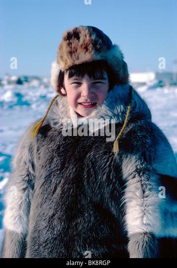 Nigel Boddy, young native boy, dressed in traditional Inuit skin clothing, Iqaluit, Baffin Island, Nunavut, Canada - Stock-Bilder