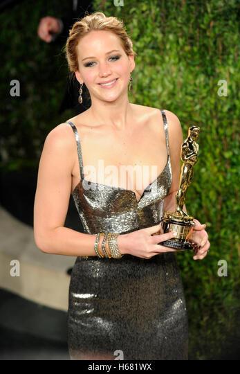Actress Jennifer Lawrence arrives with an oscar award for the 2013 Vanity Fair Oscar Party hosted by Graydon Carter - Stock Image