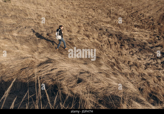 Middle Eastern woman walking on hill - Stock Image