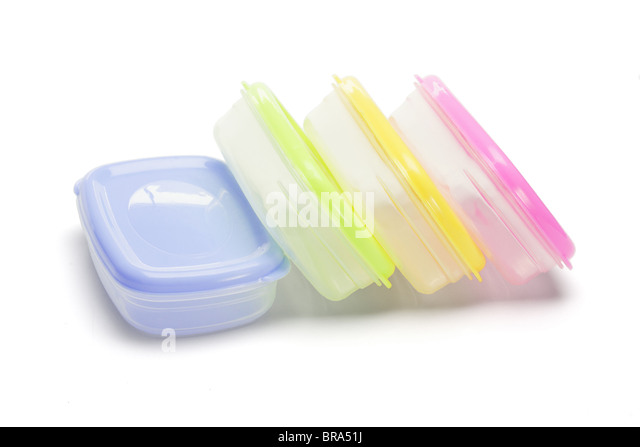Four plastic storage containers on white background - Stock Image