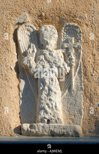 Medieval wall sign of angel, Montmorillon, Vienne, France. - Stock Image