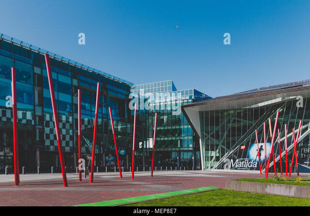 DUBLIN, IRELAND - April 21st, 2018: wide angle view of the Bord Gais Theatre and the Grand Canal Square in the renovated Dublin Docklands area - Stock Image
