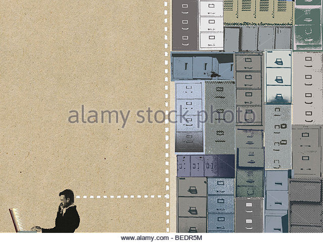 Businessman on laptop with head connected to filing cabinets - Stock Image