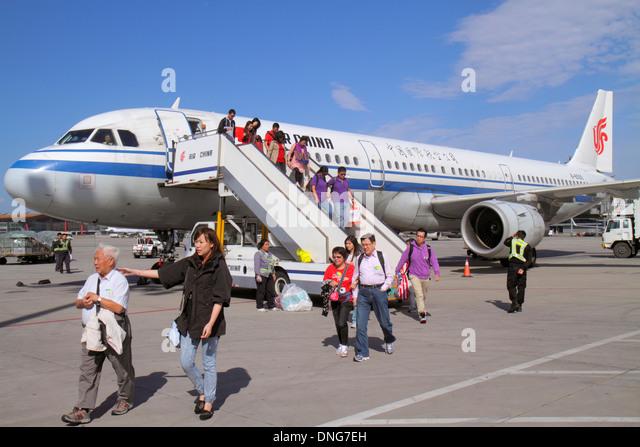 China Beijing Beijing Capital International Airport PEK Air China tarmac flight from Hong Kong passengers disembark - Stock Image