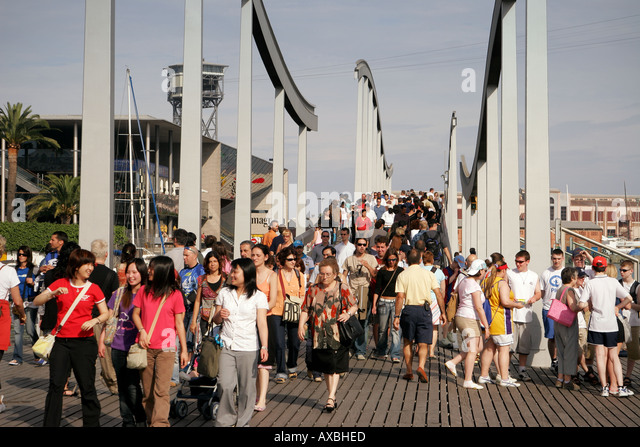 spain Barcelona Port Vell Rambla de Mar walkway crowds - Stock Image