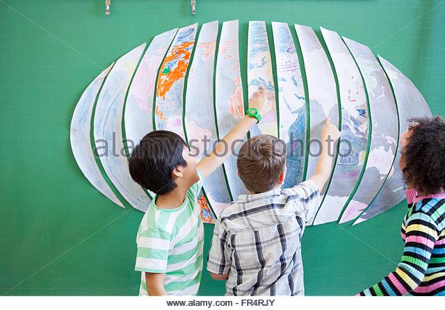 students looking at world map - Stock Image