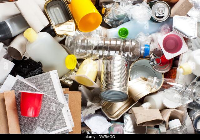 Recycling garbage and reusable waste management as metal, plastic, old paper products to be reused - Stock Image