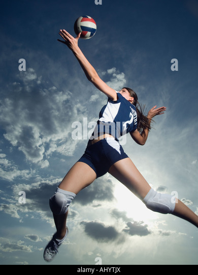 Low angle view of volleyball player jumping - Stock Image