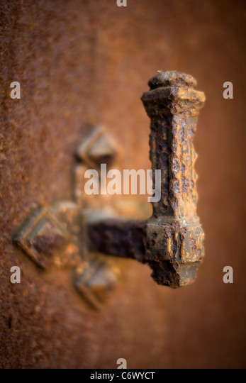 Corroded handle on tomb at Pere Lachaise Cemetery Paris France - Stock Image