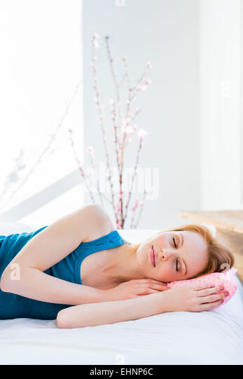 Woman in bed. - Stock Image