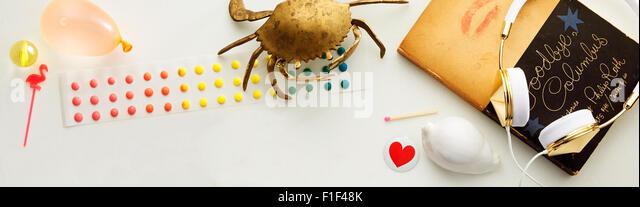 Still Life with Earphones and brass crab - Stock-Bilder