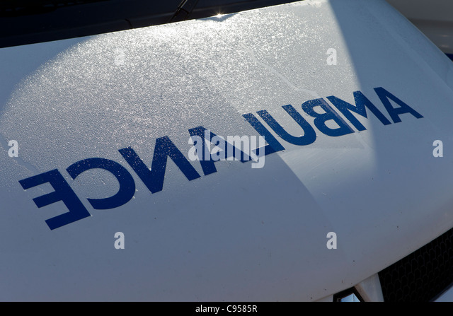 Detail of the front of an ambulance with the word AMBULANCE as a mirror image - Stock Image