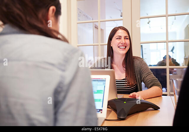 Two women working on laptops in office - Stock Image