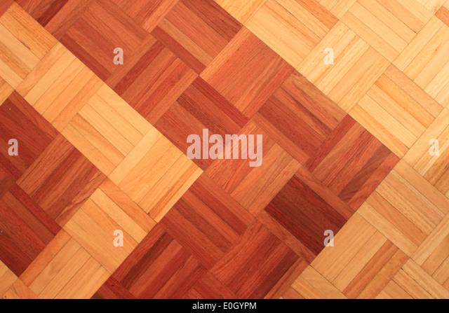Teak floor of quadratic sticks forming an arrow - Stock-Bilder