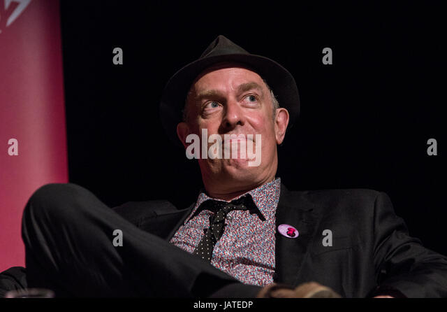 Cartoonist and writer Martin Ronson on stage in June 2017 at the 8th annual Stoke Newington Literary Festival against - Stock Image