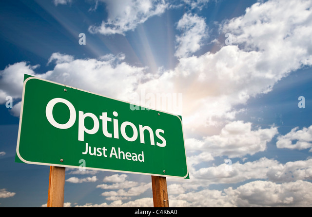 Options Green Road Sign Against Clouds and Sunburst. - Stock Image