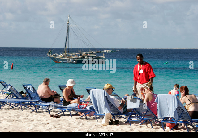Grand Turk Cockburn Town Columbus Landfall National Park Governor's Beach sunbathing Turks Island Passage - Stock Image